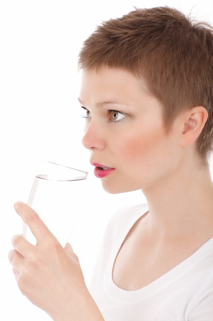 woman drinking alkaline water